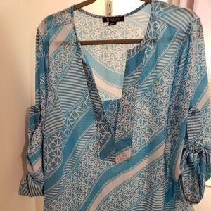 Beautiful soft and silky Roamans shirt!